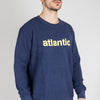 "Navy blue sweatshirt with ""Atlantic"" printed in a vibrant yellow."
