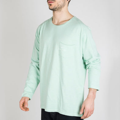Light green longsleeve with a round neck and '+351 small pocket on the front.