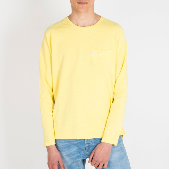 Yellow longsleeve with a round neck and '+351 small pocket on the front.