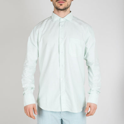Slim fit light green shirt with point collar, long sleeves, button-up front, buttoned cuffs and a pocket.