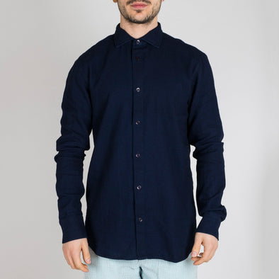 Slim fit blue denim shirt with point collar, long sleeves, button-up front and buttoned cuffs.