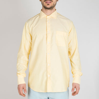 Slim fit yellow shirt with point collar, long sleeves, button-up front, buttoned cuffs and a pocket.