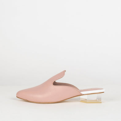 Soft pink mestizo leather mules with architectural heel.