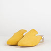 Mustard yellow suede and leather mules with architectural heel.