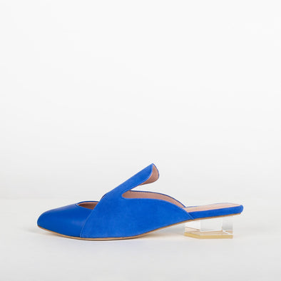 Electric blue suede and mestizo leather mules with architectural heel.