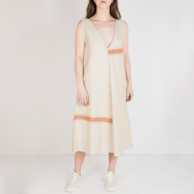 Oversized and flared dress with two fronts. Can be worn on the deeper or higher neckline side.