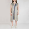 Asymmetric vest dress with short sleeves and a collar.