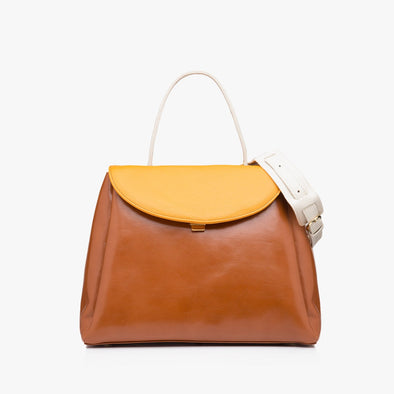 Classic large handbag in leather with camel brown body, gold yellow flap, off-white thin handle and detachable strap