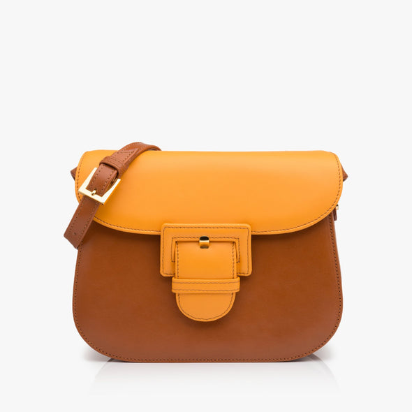 Saddle bag in camel brown leather and gold yellow flap with large buckle