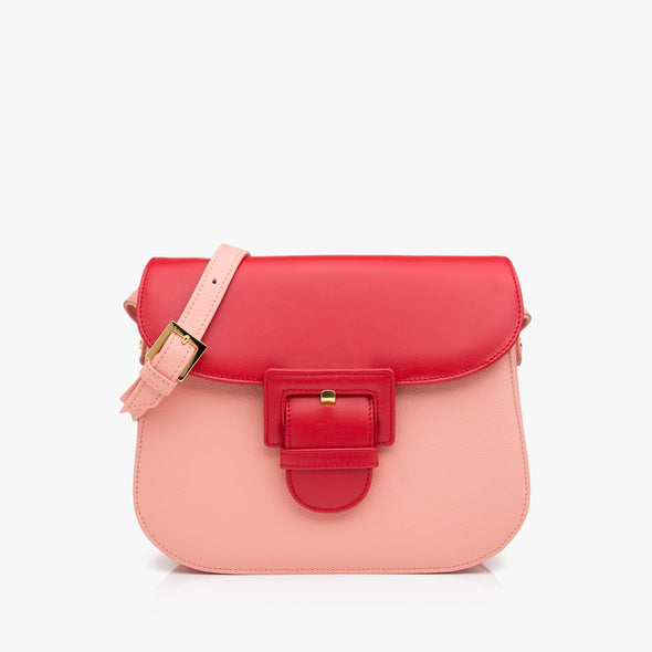 Saddle bag in soft pink leather and red back and red flap with large buckle