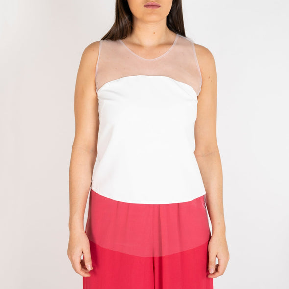 Tule top with a white opaque panel.