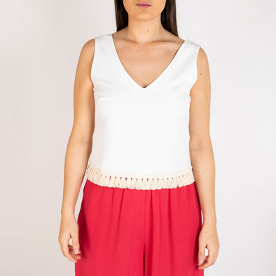Plain white top with cotton fringe at the bottom.