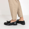 Classic moccasin loafers in black polished leather with two tassels