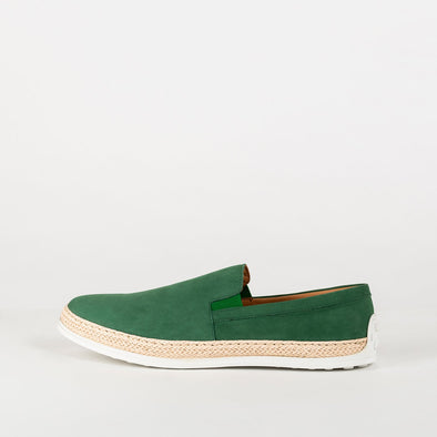 Comfortable green leather loafers with white sole.
