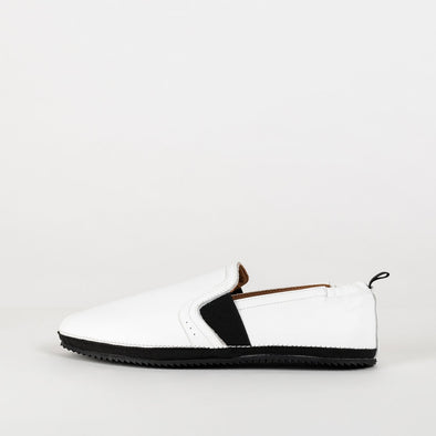 Comfortable white leather loafers with black sole.