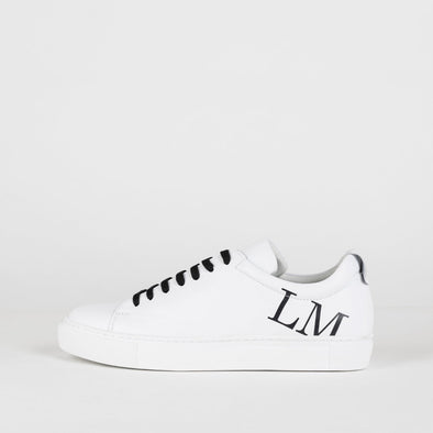 White leather sneakers with black LMK print (LM on one side and K on the other)