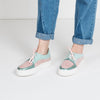 Platform sneakers in a soft pink and green pastel colorblocked scheme with a metallic detail.,