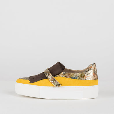 Slip on shoes in paneled look with multi-colored snake-embossed leather body, yellow suede side panels and brown suede fringe, with white rubber platform sole