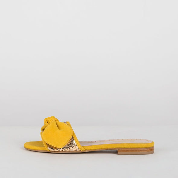 Slippers in canary yellow suede with coppery sequin applique and bow