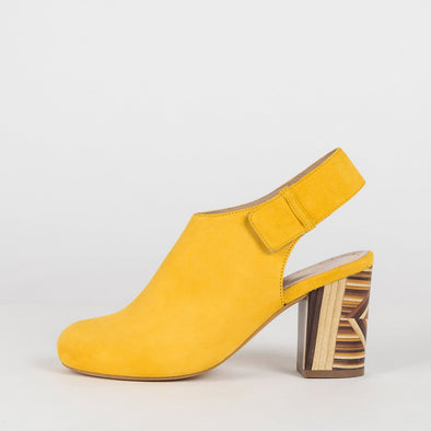 Yellow suede bootie inspired sandals with woody patterned heel.