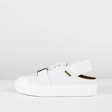 Low top sneakers in white leather with cut out ankle and elastic and golden clasp applique