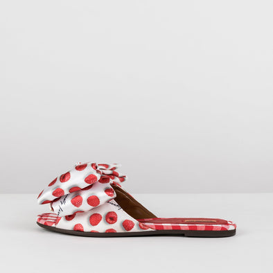 Slides in a raspberry-print pattern with a bow