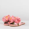 Slides in pink fabric with two rose appliques
