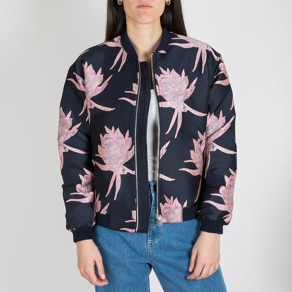 Luminous navy blue bomber jacket with lily flowers embroideries.