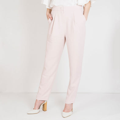 High waisted baby pink trousers in a light material.