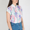 Sleeveless loose and printed top with an asymmetry game starting from the shirt collar.