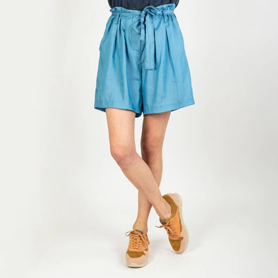Indigo shorts with a strap to tie at the waist.