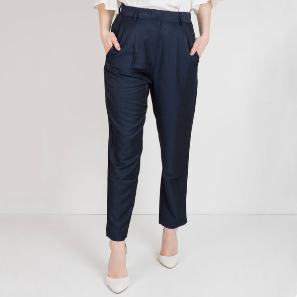 High waisted navy blue trousers in a light material.
