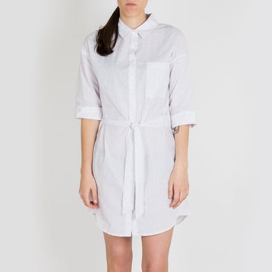 White shirt dress in pure embossed cotton print. Features a belt.