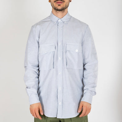 Blue striped shirt made from 100% cotton with a regular fit featuring two frontal military pockets.