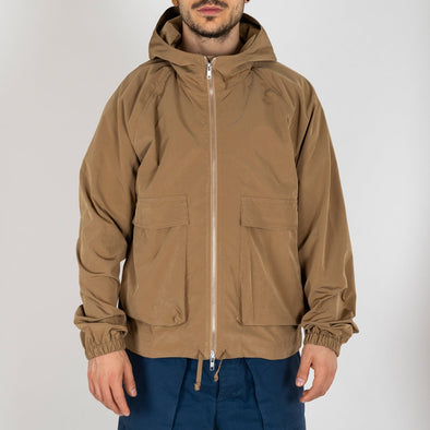 Beige water repellent lightweight jacket, with two front pockets.