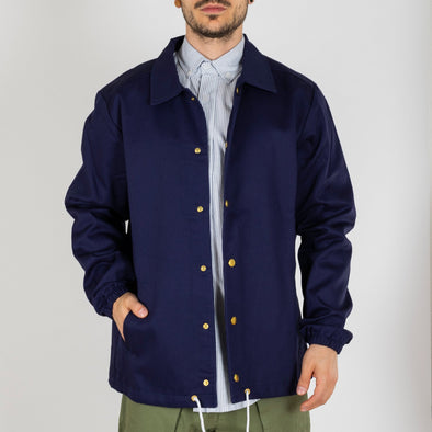 Navy blue version of the coach jacket.