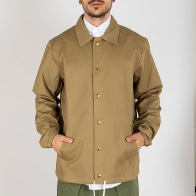 Beige version of the coach jacket.