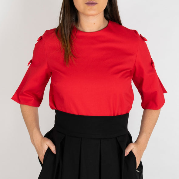 Bright red bodysuit featuring a mid-length sleeves with two bows each.
