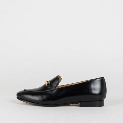 Black leather loafers with a golden detail.
