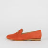 Orange suede loafers with a golden detail.