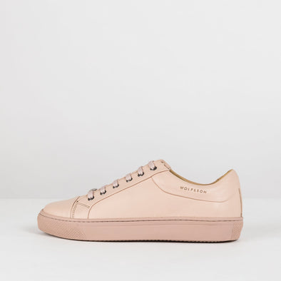 Low top lace up sneakers in nude pink leather with matching rubber sole