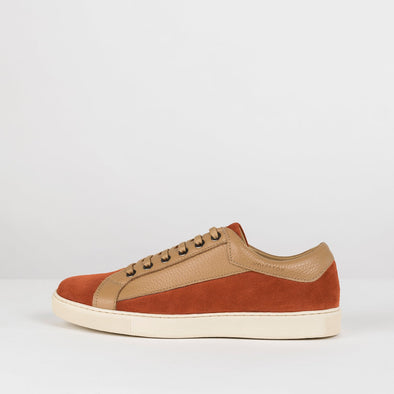 Low top lace up sneakers in orange rust suede with beige leather side panels and white rubber sole