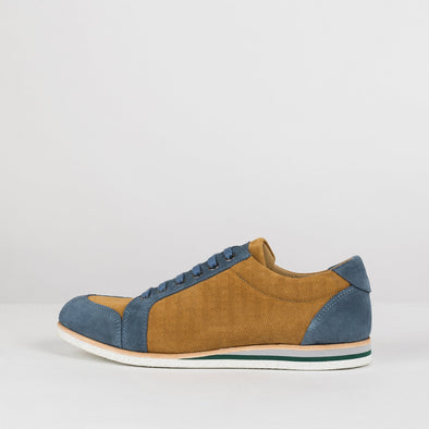 Low top lace up sneakers in birch yellow suede with sky blue panels and subtle engraving on the side panels