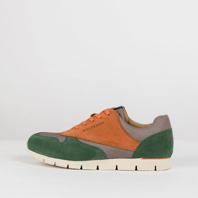 Classic lace-up runners in paneled forest green and orange suede and warm grey mesh-texture fabric, with white rubber sole