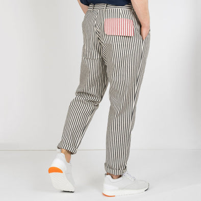 Black and white striped pants with a red striped pocket at the back.