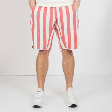 Loose red and white striped shorts with an elastic band.