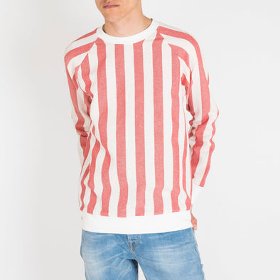 Red and white striped raglan sweater.