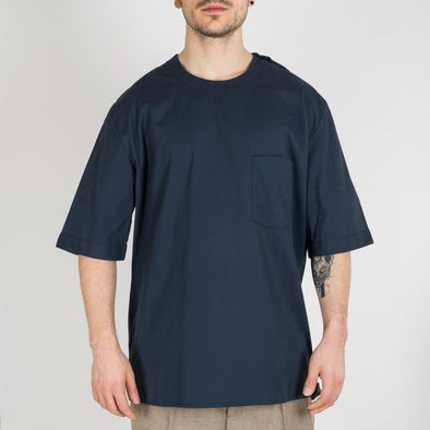 Navy blue crewneck shirt with a simple front pocket.