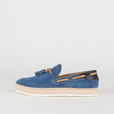 Loafers in blue colored suede with tassels and camel details.