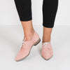 Pointed-toe oxford shoes in pastel pink suede with leaf-shaped stitchwork